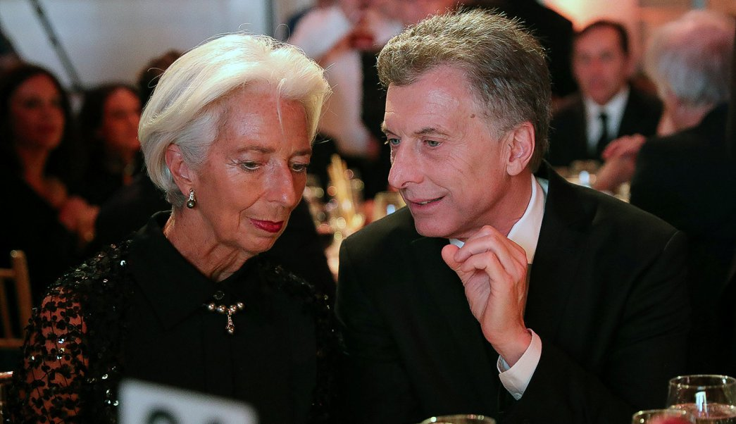 Christine Lagarde, Managing Director of the International Monetary Fund (IMF) and Argentina's President Mauricio Macri talk during a ceremony at the Atlantic Council in New York